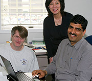 photo of faculty member working with students